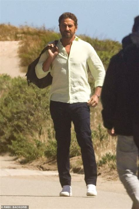 Gerard Butler bares his buff arms while stepping out in