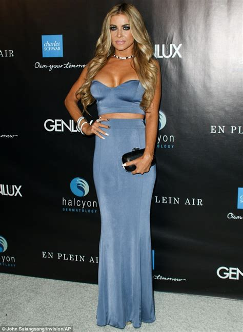 Carmen Electra shows plenty of skin in blue outfit at
