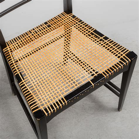 A set of four 'Poem' chairs by Erik Chambert, Chamberts